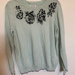 Cute lightweight sweater with beaded detailing